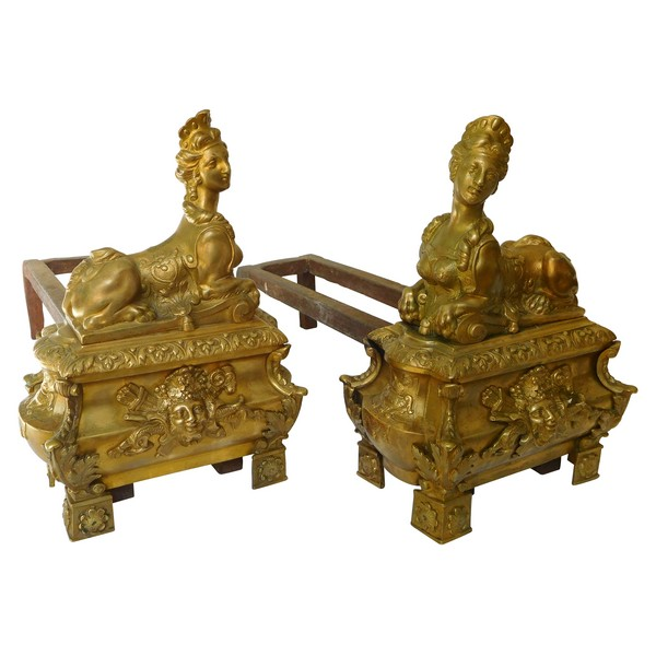 Pair of ormolu Regency style andirons, sphinge decoration, 19th century