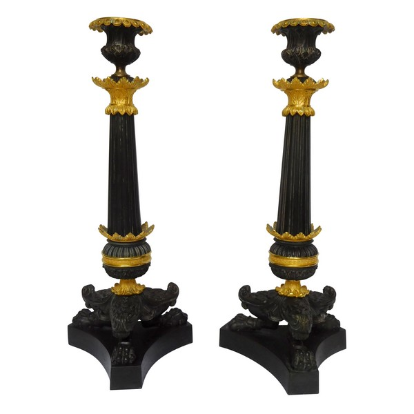 Pair of Empire patinated bronze and ormolu candlesticks, early 19th century circa 1820