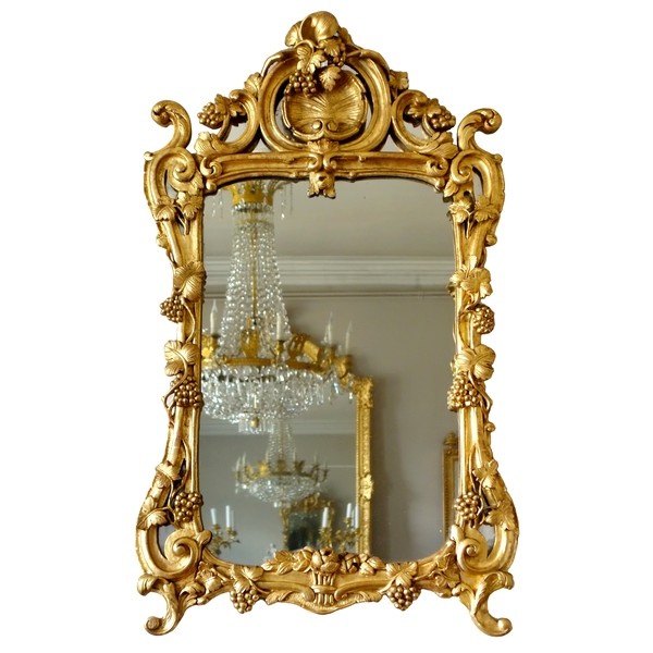 Louis XV gilt wood mirror, mercury glass, 18th century