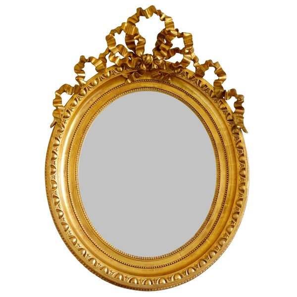 Tall Louis XVI style gilt wood oval mirror, Napoleon III period - 77cm x 104cm