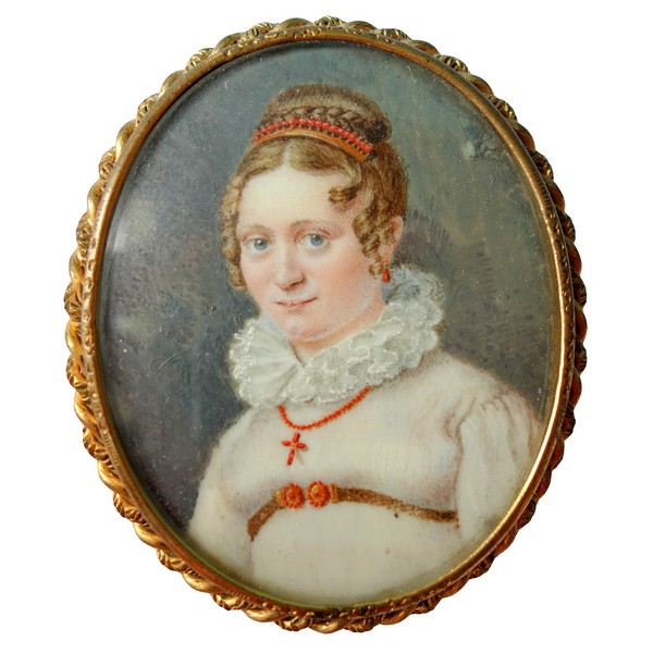 Miniature portrait on mother-of-pearl : young woman wearing coral jewellery, early 19th century
