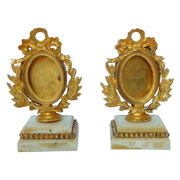 Pair of ormolu and ivory miniature frames - Louis XVI style, mid 19th century